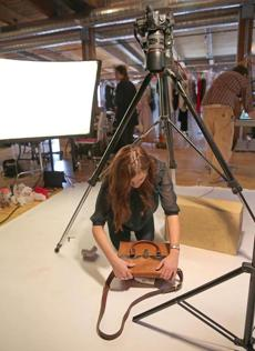 Jess LePrevost set up a product shoot for Fashion Project, which helps nonprofits get higher prices by selling online.